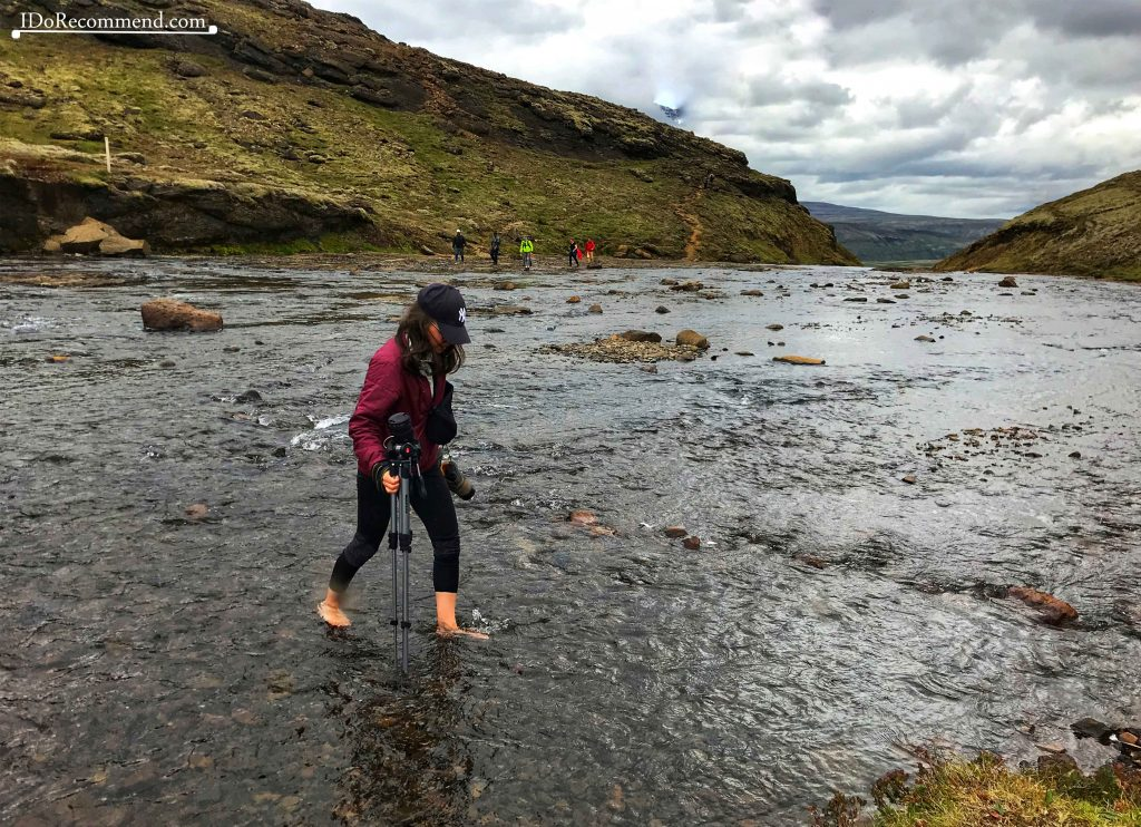 Wading the river on top of the Glymur waterfall